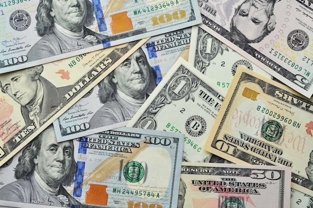 お金はテクスチャ米ドル紙幣をクローズアップ