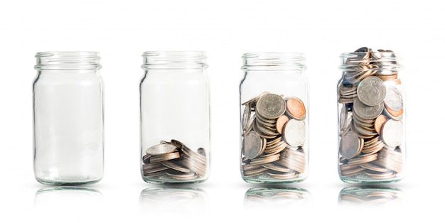 Money coins growing in jar.