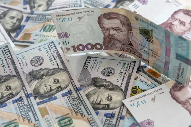 Money concept exchange. dolla to uah gryvna bills. money