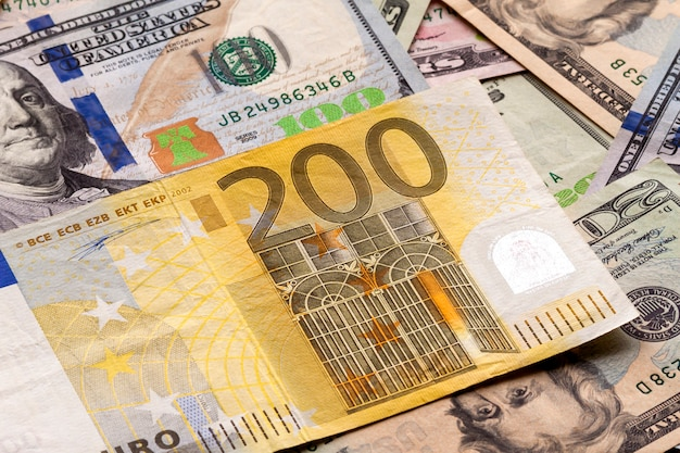 Money and finances concept. two hundred euro new bill on colorfu