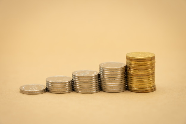 Money, financial, business growth concept, stack of coins tinvestment analysis