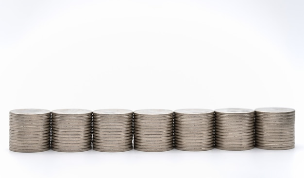 Money and financial concept. closeup of stack of silver coins on white background.