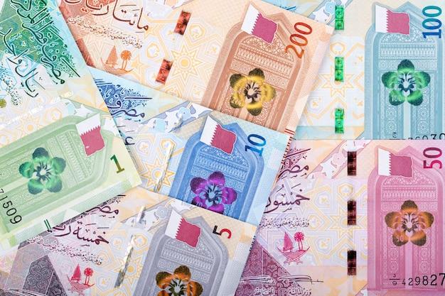 Money from qatar - riyal a background