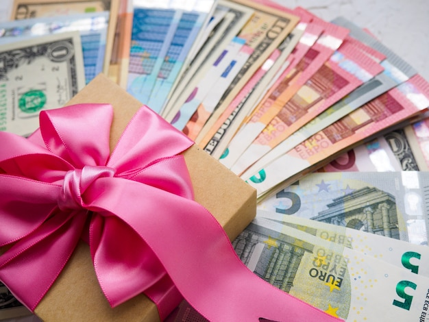 Money gift box and a lot of money for christmas