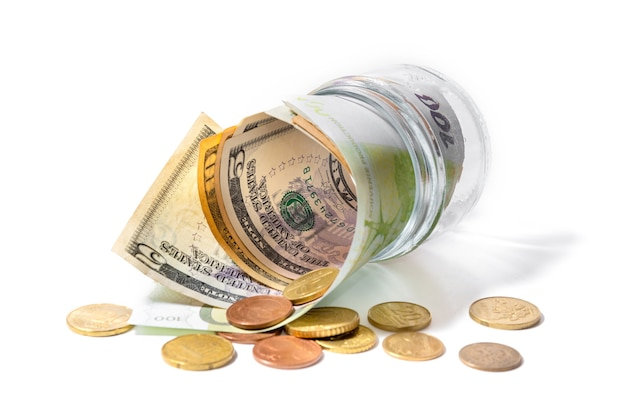 Money in a glass jar with on a white
