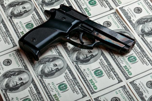 Money and gun.dollars