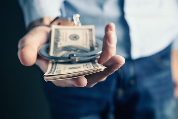 Money and handcuffs bribery of the authorities