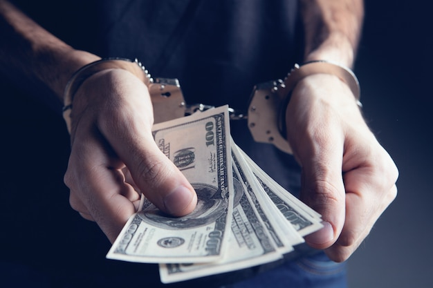 Money and handcuffs bribery of the authorities