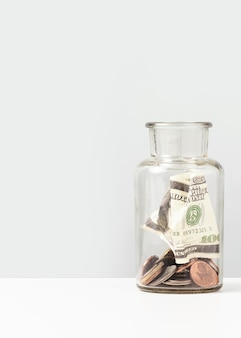 Money inside of a bottle with copy space