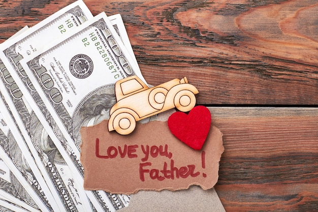 Money, pyrography car, greeting card. fabric heart on envelope. life is motion.