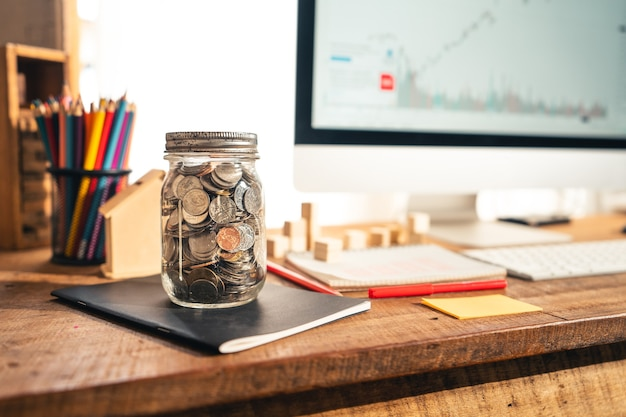 The money saving jar on the desk at home