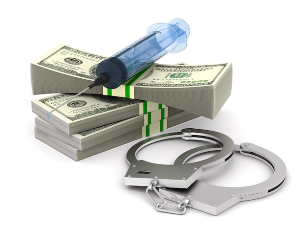 Money and syringe and handcuffs on white space