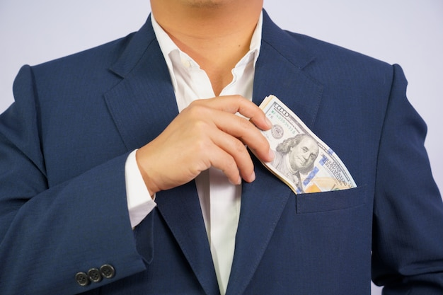 Money in usa hold on hand business man wearing a blue suit usd