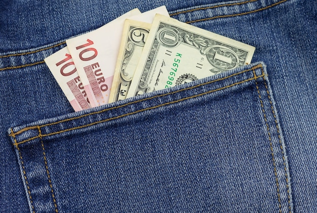 Money in your pocket. bills in the back pocket of jeans. the concept of pocket money. cash. money of various denominations. close-up. business, trade or financial transactions.