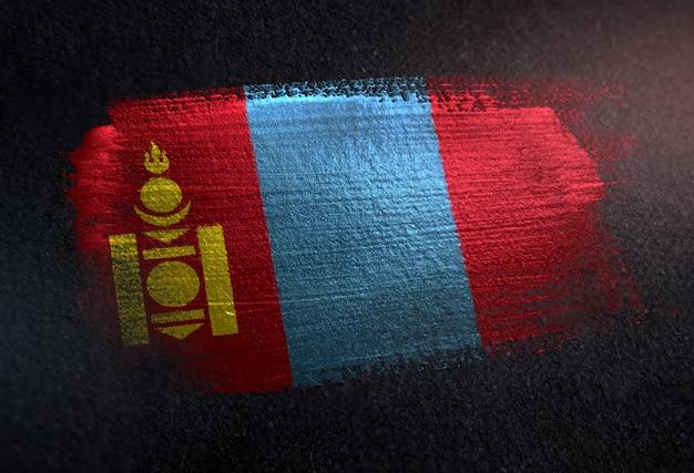 Mongolia flag made of metallic brush paint on grunge dark wall