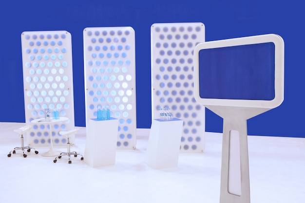 Monitor for information with booth backdrop