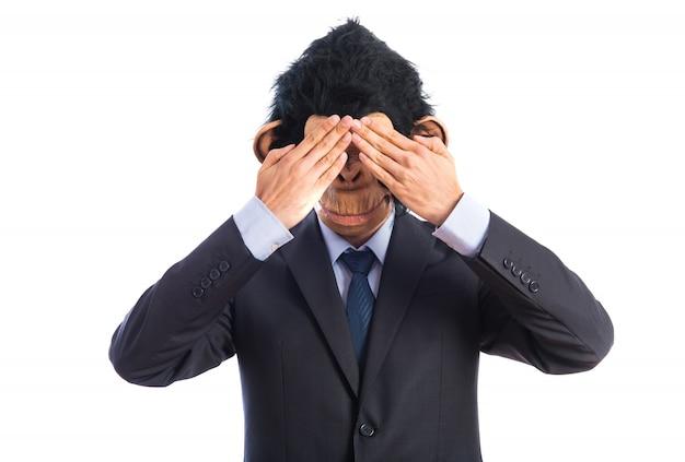 Monkey man covering his eyes