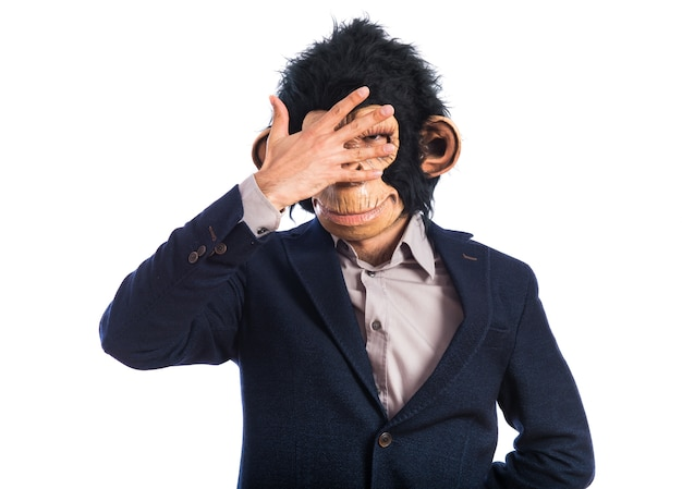 Monkey man covering his face