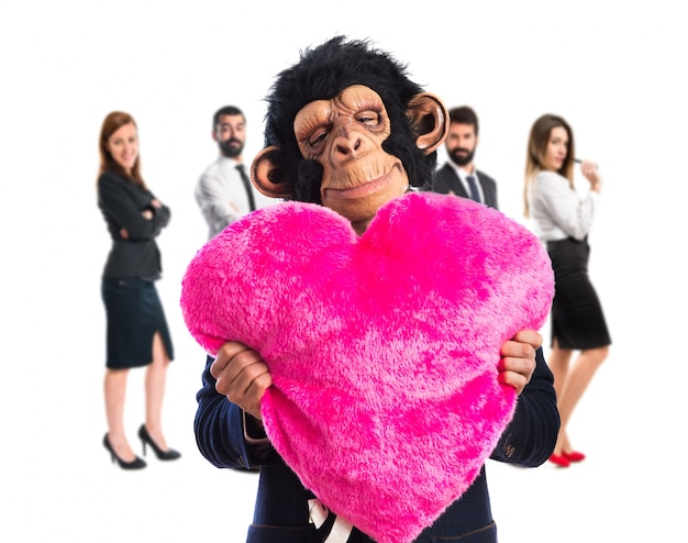 Monkey man holding a big heart
