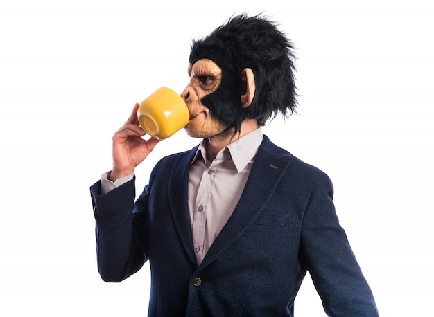 Monkey man holding a cup of coffee