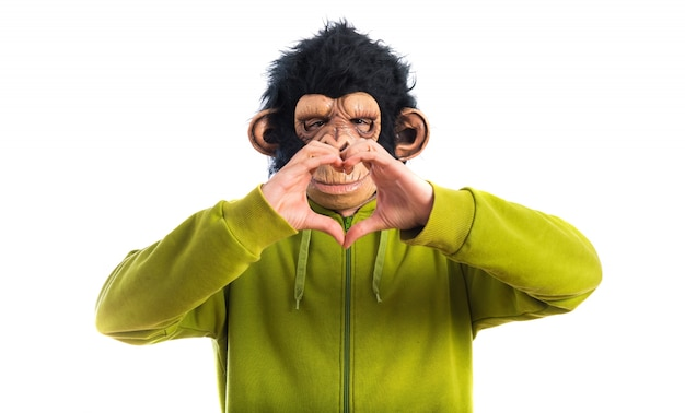 Monkey man making a heart with his hands