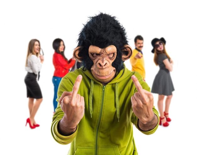 Monkey man making horn gesture