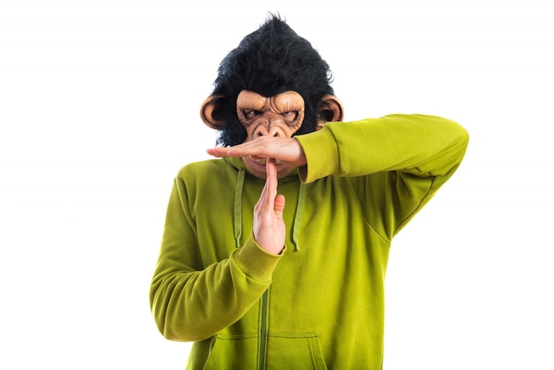Monkey man making time out gesture