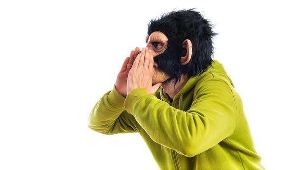 Monkey man shouting over white background