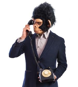 Monkey man talking to vintage phone