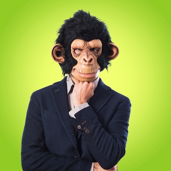 Monkey man thinking over white background   on colorful background