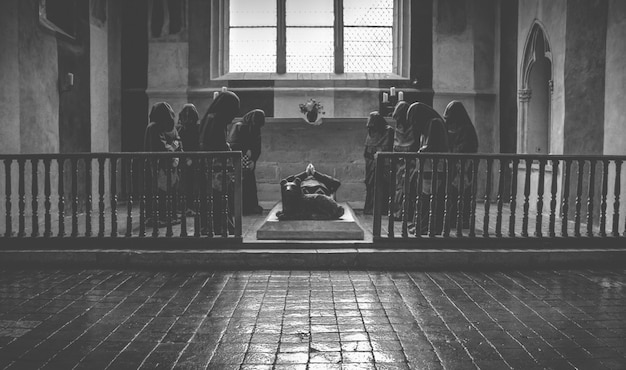 Monks praying at funeral