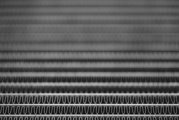 Monochrome background image of automotive radiator close up