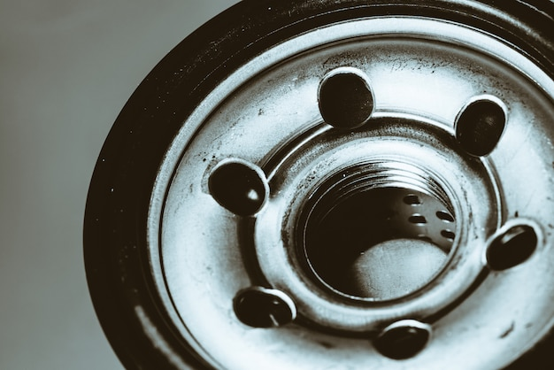Monochrome background image of oil filter close up.