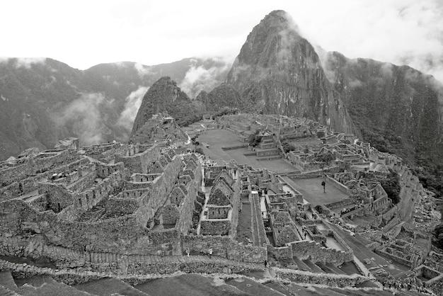 Monochrome image of machu picchu incan citadel unesco world heritage site in urubamba peru