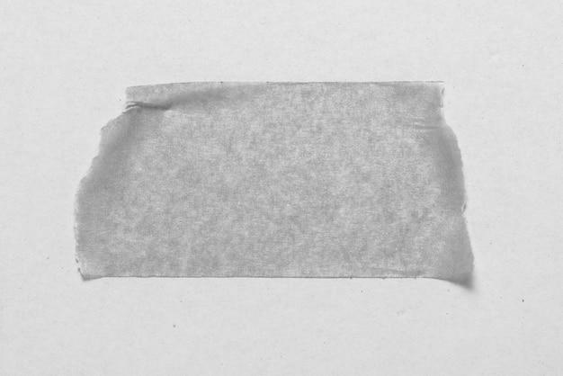 白い背景の上のmonockromeスティックテープ