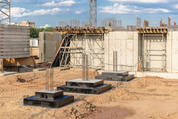 Monolithic reinforced concrete foundations for the construction of a residential building. grillage at the construction site. construction pit with foundations.