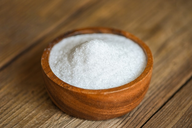 Monosodium glutamate on wooden bowl on the table