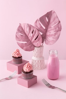 Monstera plants and pink cupcakes
