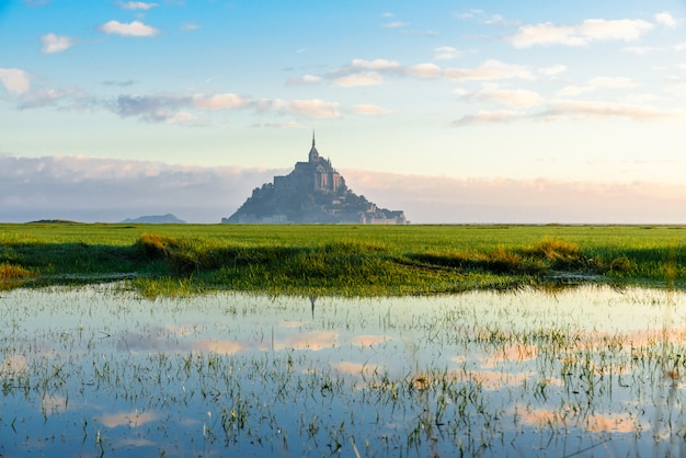 Mont saint michel abbey on the island with reflection, normandy, northern france, europe