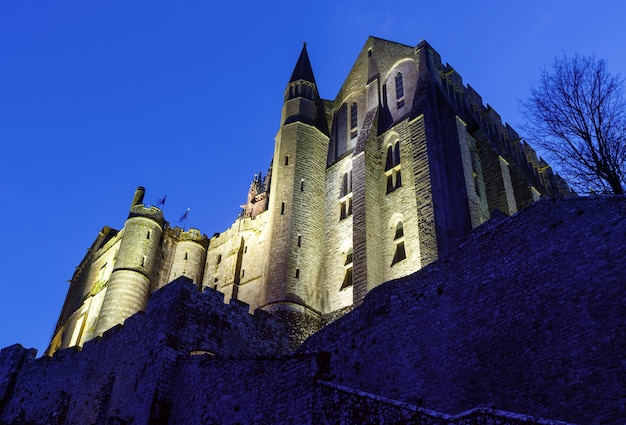 Mont saint-michel night view.  built in the xi-xvi centuries. the main facade of the church  built in the 12th century. architect  william de volpiano.