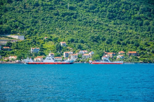 Montenegro sea ferries carry cars and buses with tourists between the two cities