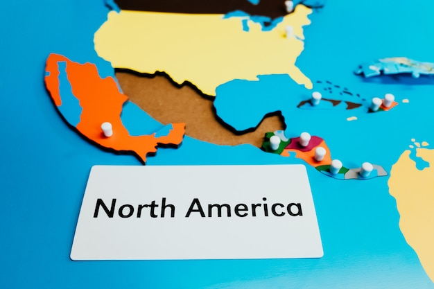 Montessori map of north america made of wood with text label in a school.