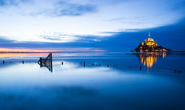 Montsaintmichel sunset with deep blue water and clear reflections normandy france