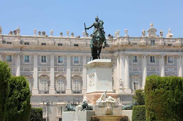 Monument to philip iv of spain with royal palace of madrid, spain