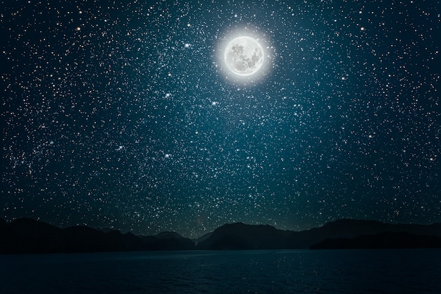 Moon against a bright night starry sky reflected in the sea elements of this image furnished by nasa