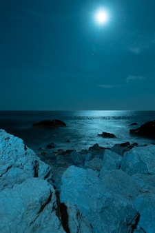 Moon above beautiful crystalline water