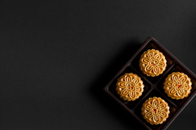 Moon cake on black background