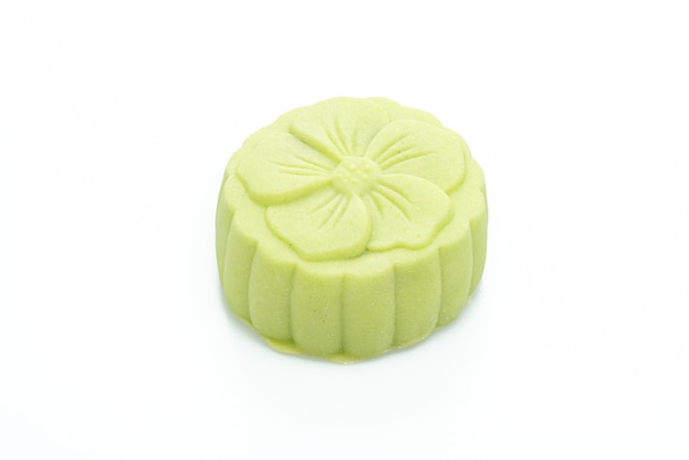 Moon cake green tea and red bean flavour isolated on white