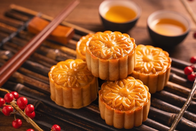 Moon cake mooncake table setting - round shaped chinese traditional pastry with tea cups