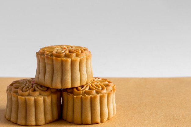 Moon cake on white and brown background